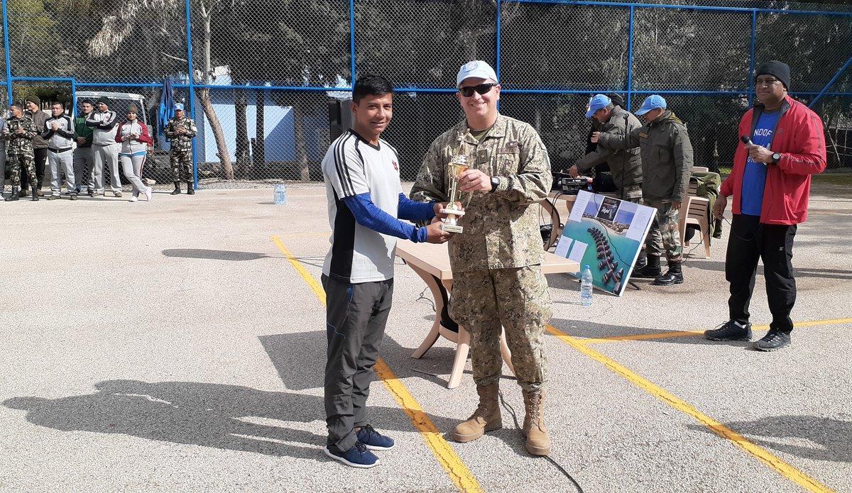 Team Captain of NMC, Capt Suraj Malla receiving the Winning Trophy from COS Col Martin Alvarez