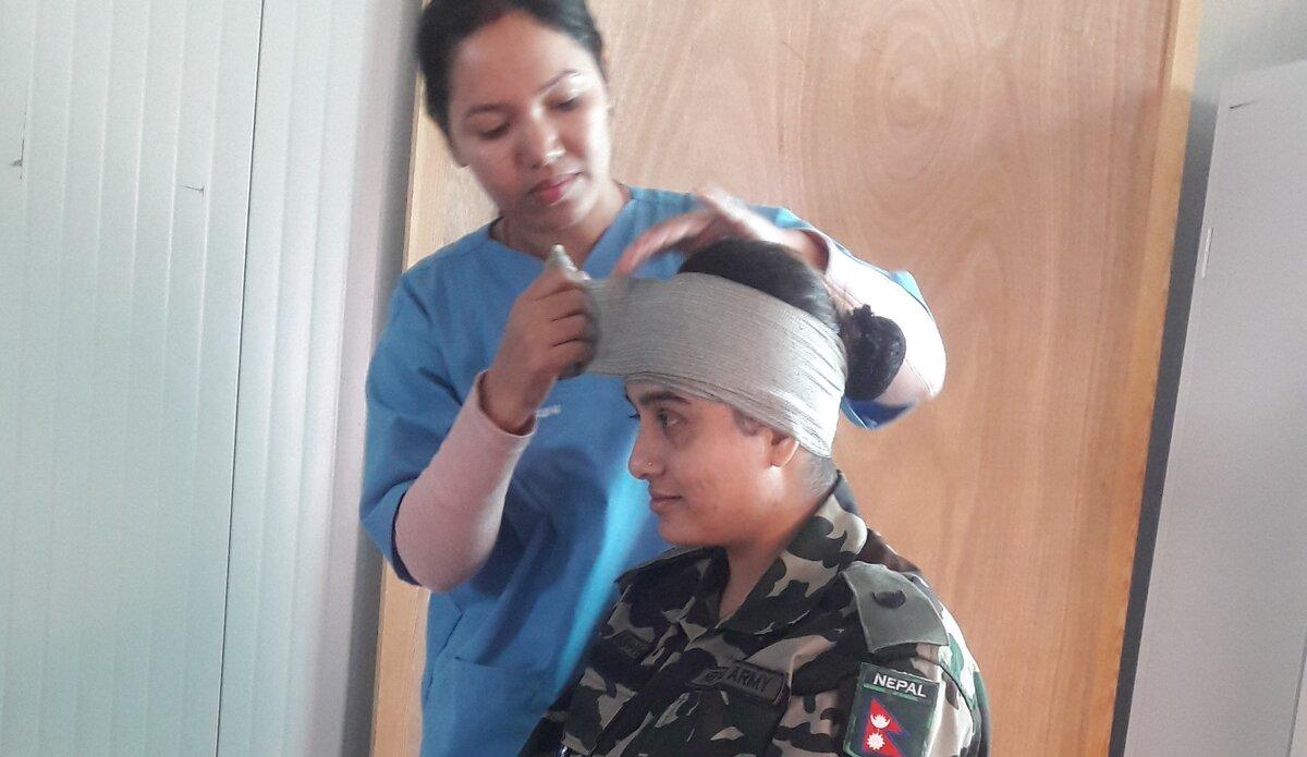 Basic First Aid Responder Course: Head Injury Care Demonstration by WO1 Sabitri Pudasaini and WO1 Menuka Bhattarai