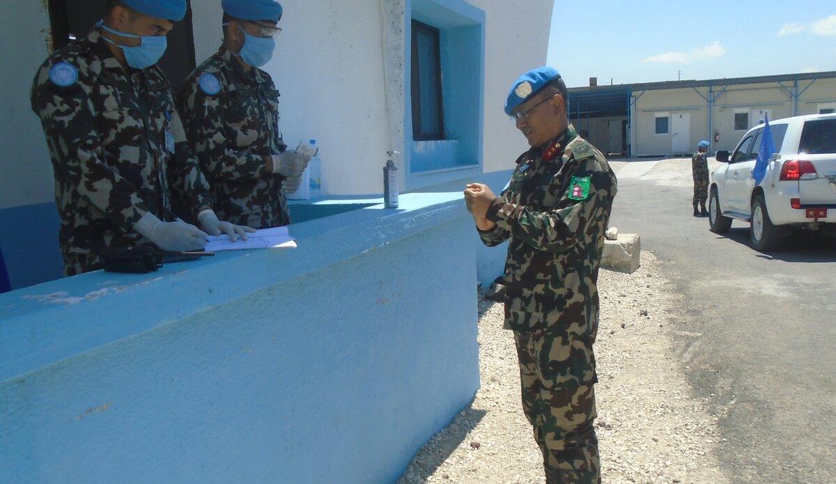 HoM/FC Maj Gen Ishwar Hamal Using Hand Sanitizer at UNP 37.