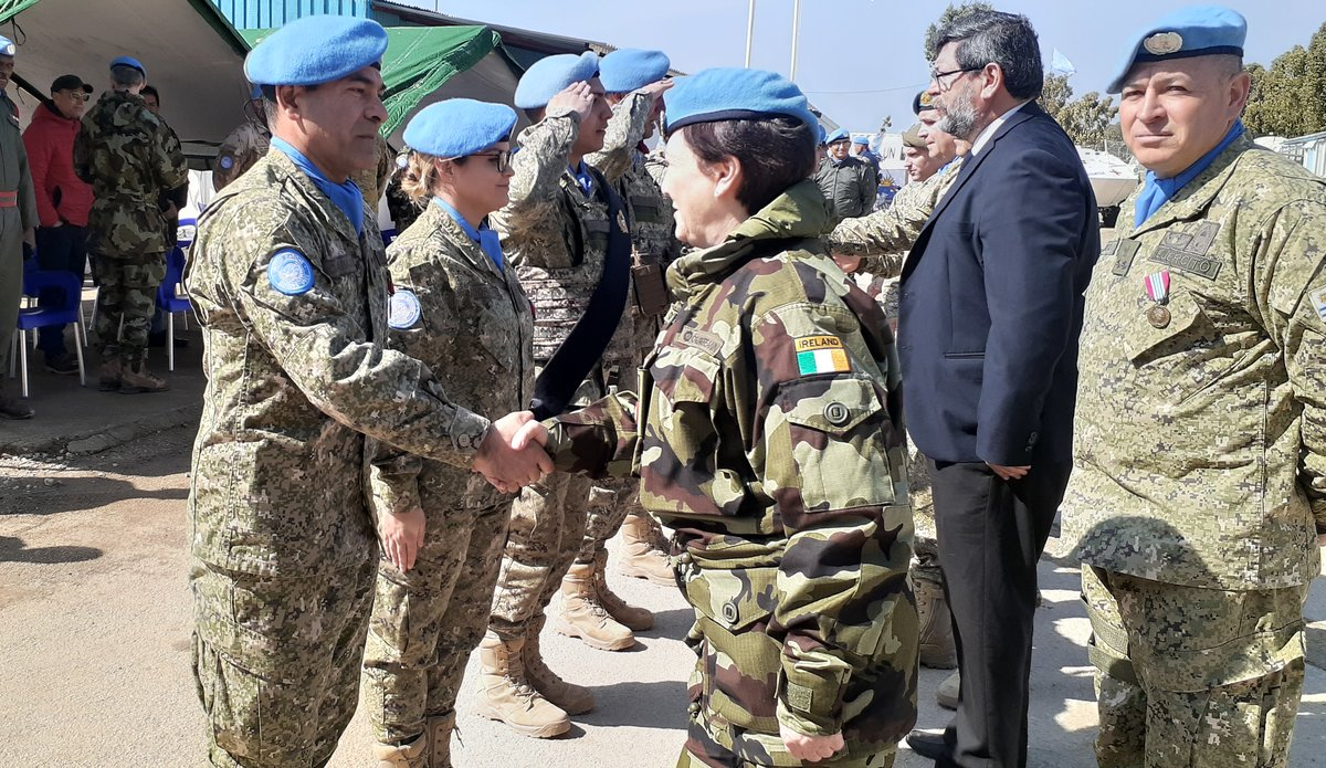 A/FC Brig Gen M O Brien congratulates members of UMIC on receiving their UNDOF Medal.