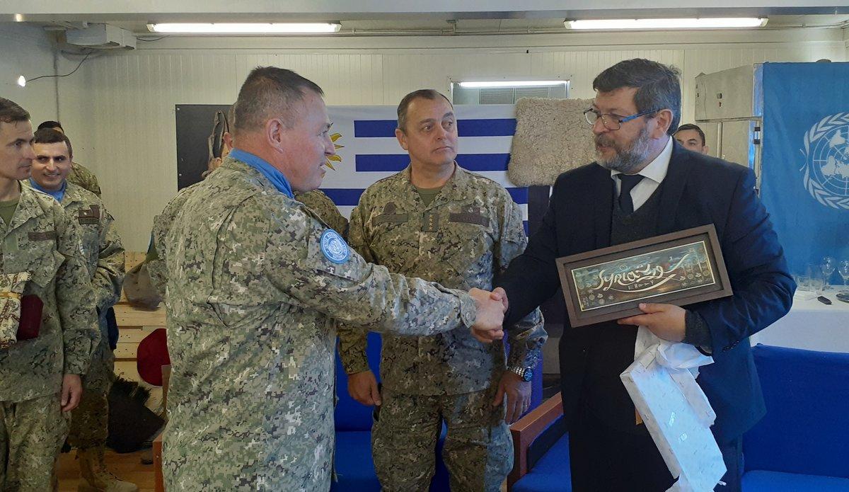 UMIC Commanding Officer Lt Col Ramirez makes a presentation to Deputy Minister Mr Berterreche Paz.
