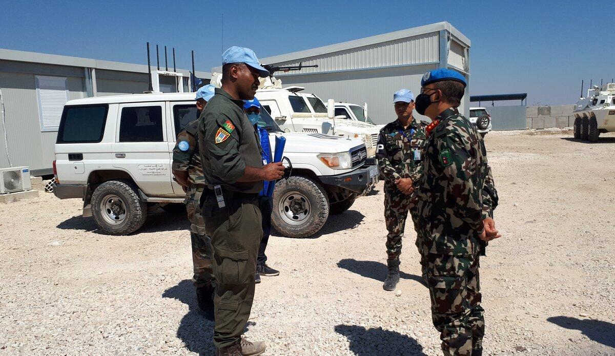 Major Kalisiana Jioji briefing HoM/FC on construction of the UNP.
