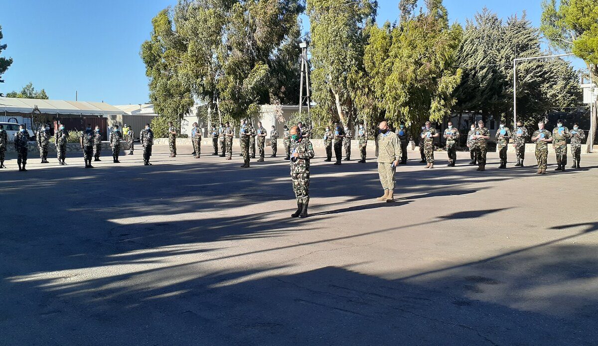UNDOF Force Commander leads the parade in a minute's silence in Camp Faouar
