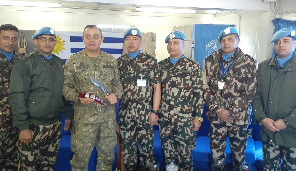 Nepalese Senior Officers of UNDOF present General Feola Paz with a Kukuri