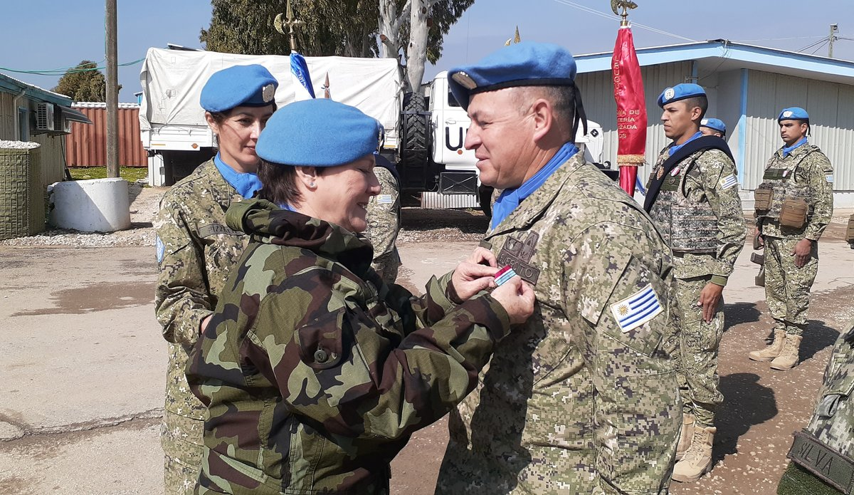 Acting Force Commander Brig Gen Maureen O'Brien presenting Peace Keeping Medal to UMIC CO.
