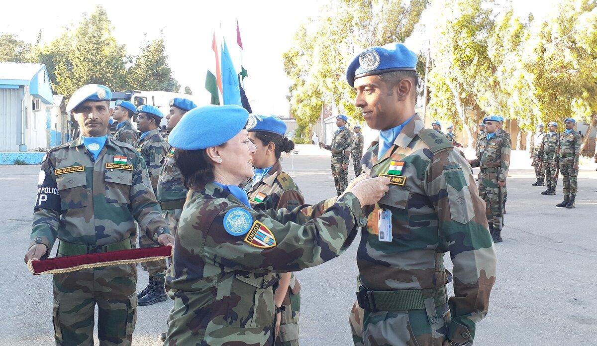 A/FC UNDOF Brig Gen M O'Brien presents Lt Col Suhel Nagarkar, CO INDCON, with his UNDOF Medal