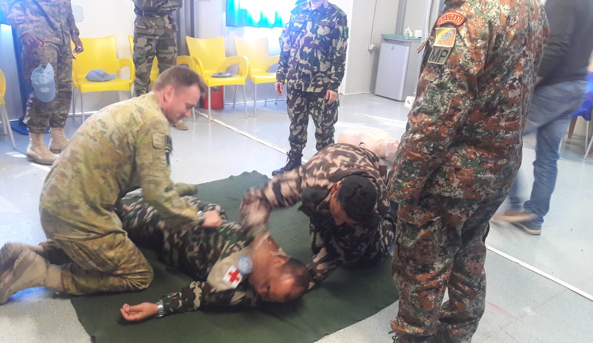 First Aid Training: Trainees Performing the Recovery Position