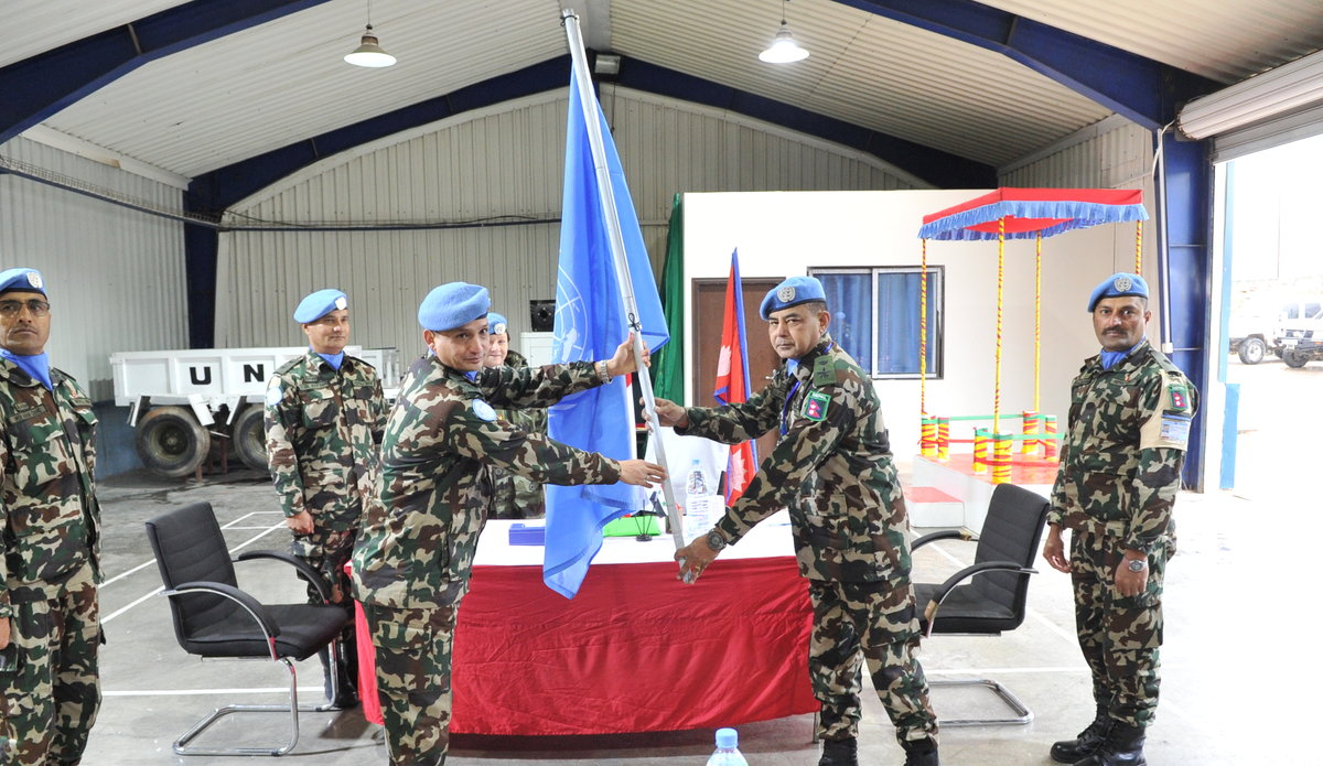 HANDOVER OF UN FLAG BY OUTGOING COMMANDER LT COL AMAR SINGH THAPA TO INCOMING COMMANDER LT COL JAYSON S.J.B. RANA
