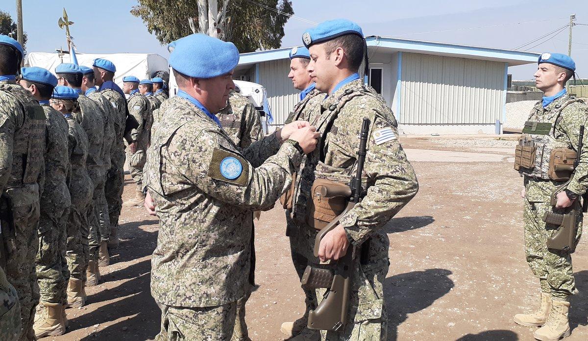 Col M Alvarez COS UNDOF presents UNDOF medal to Uruguayan peace keeper.