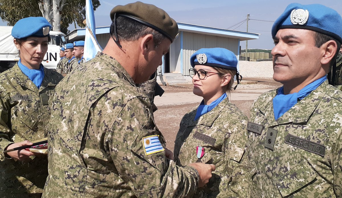 Guest of honor General of the Uruguayan General Feola Paz presents medals to the Uruguayan Contingent.
