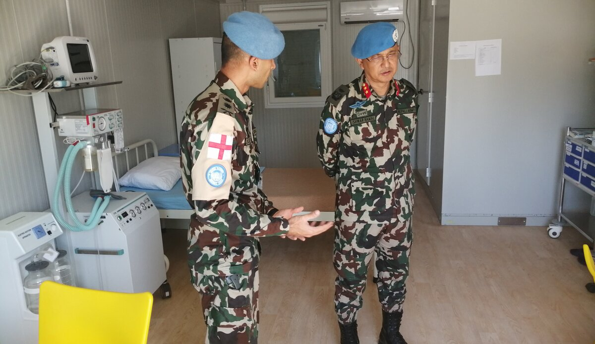 Capt. Dr. Ayush Rayamajhi breifing the HoM/FC on status of COVID - 19 in UNDOF