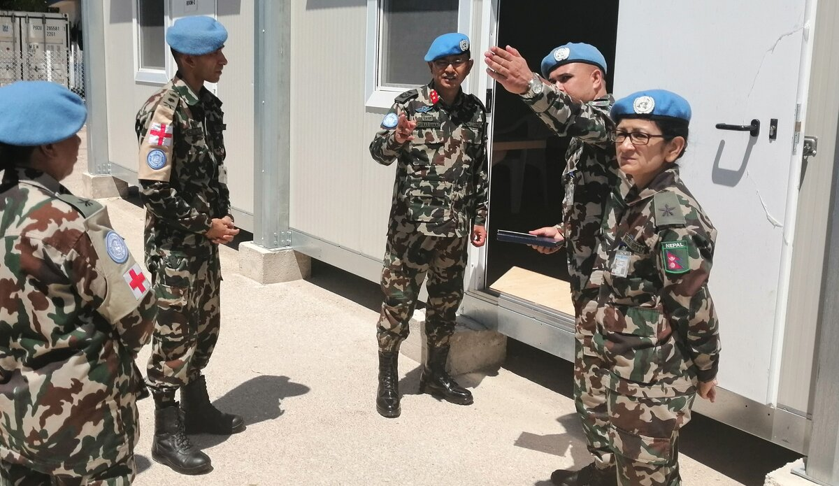 Lt. Col. Dr. Narayan Thapa briefing the HoM/FC Major General Ishwar Hamal on COVID - 19 capabilites