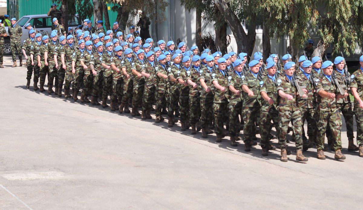 Troops of FRC 60 Inf Gp FRC prepare to go on parade