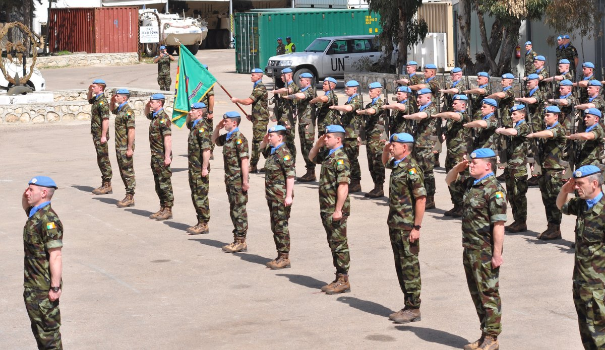 Officers NCOs and Men from Irish Contingent salute the arrival of A/FC M O Brien on parade