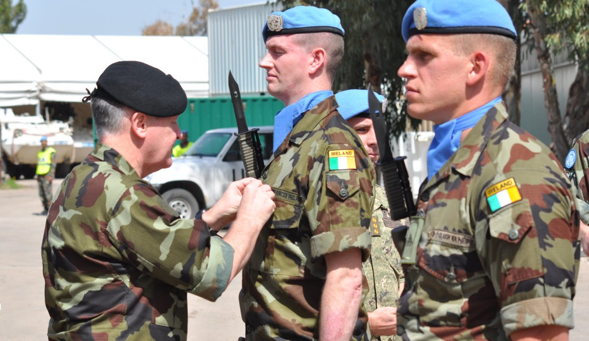 Maj Gen A Mckenna D COS Ops Irish Defence Forces presents medals to members of Irish Contingent FRC