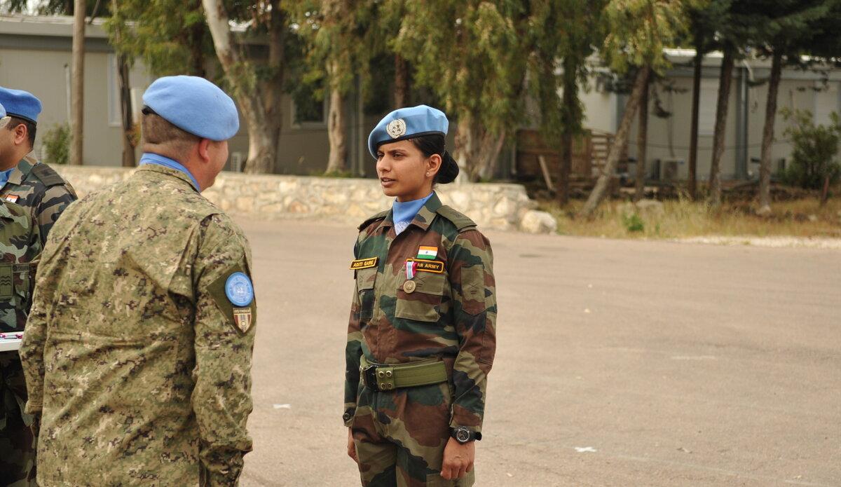 Maj Aditi receives the UNDOF Medal from Chief of Staff M Alverez.