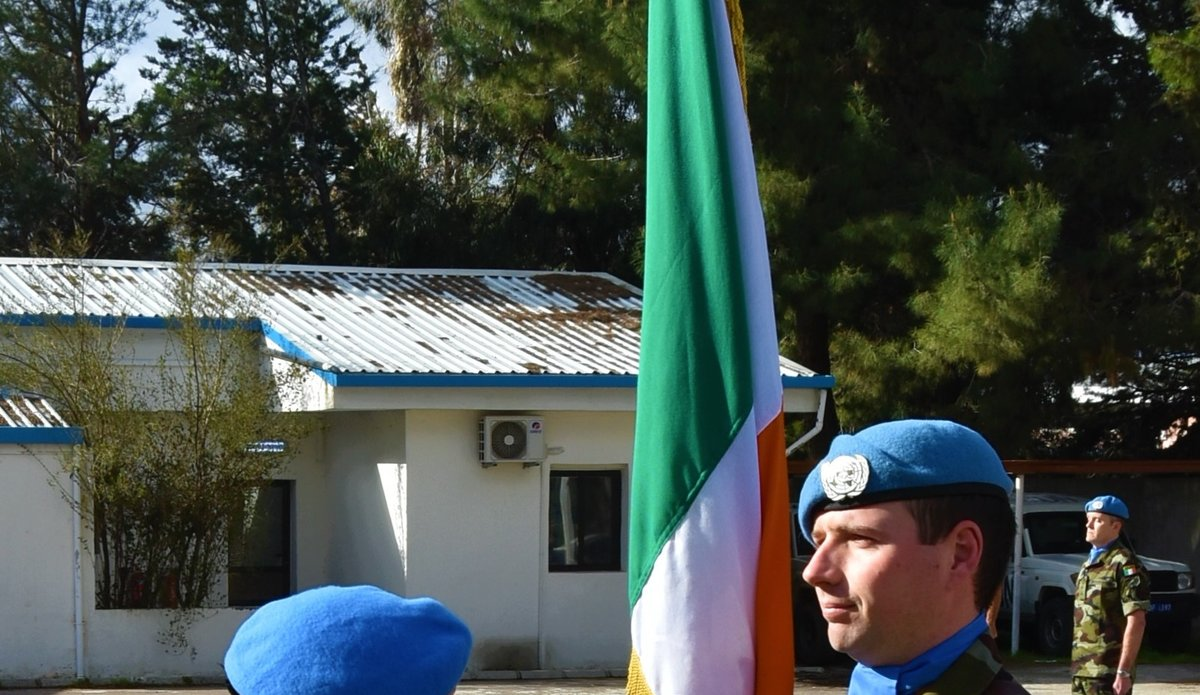 A/FC Brig Gen M.O.Brien presents the National Flag bearer with Shamrock.
