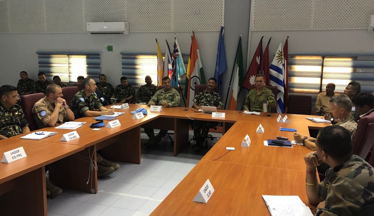 UNDOF Staff Officers listen to a brief on the current operations of UNTSO