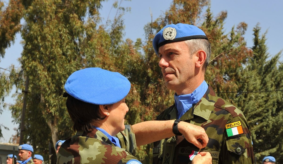 A/FC UNDOF Brig Gen M O Brien presents the UNDOF Medal to Chief Operations Officer UNDOF HQ Lt Col Oliver Clear.
