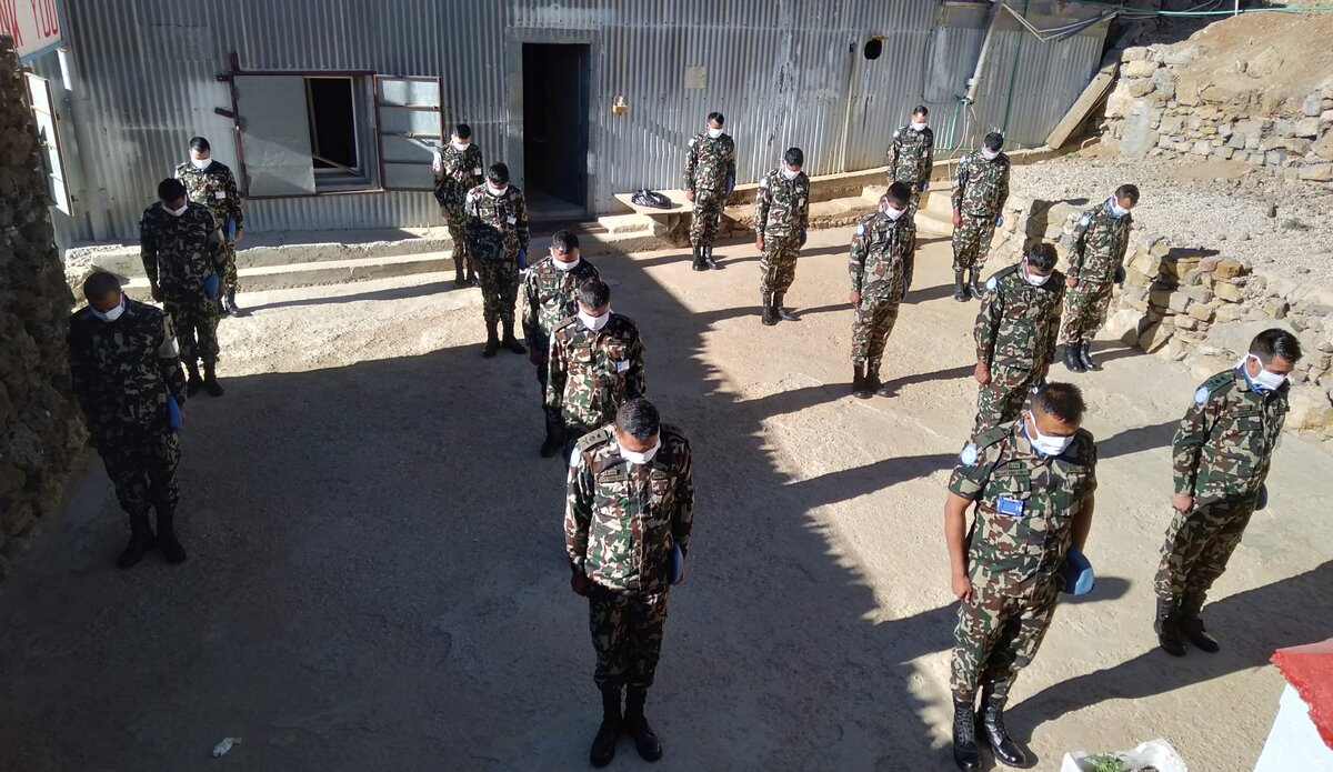Nepalese Contingent (NEPCON) in UNP Hermon Base observing the minute's silence