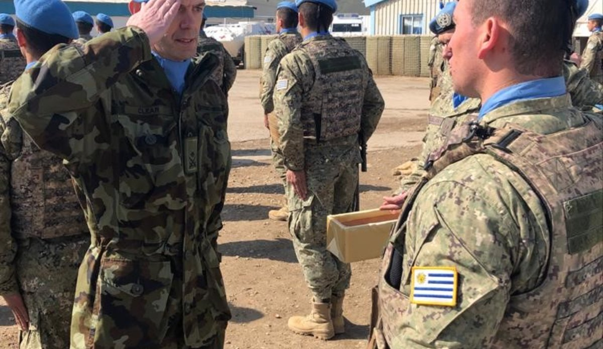 Lt Col Olivier Clear COO UNDOF salutes UMIC peace keeper after presenting the UNDOF medal.