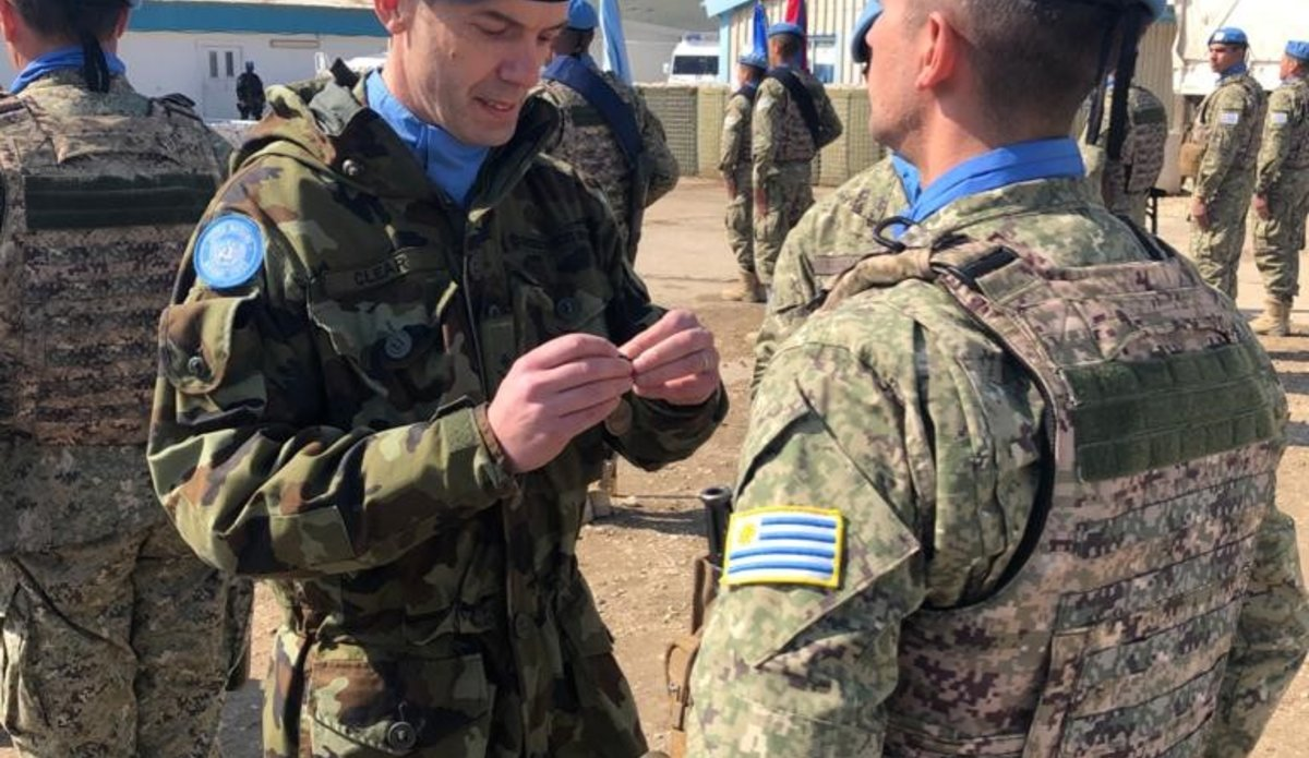 Lt Col Clear COO UNDOF presents UNDOF medal to UMIC peace keeper.
