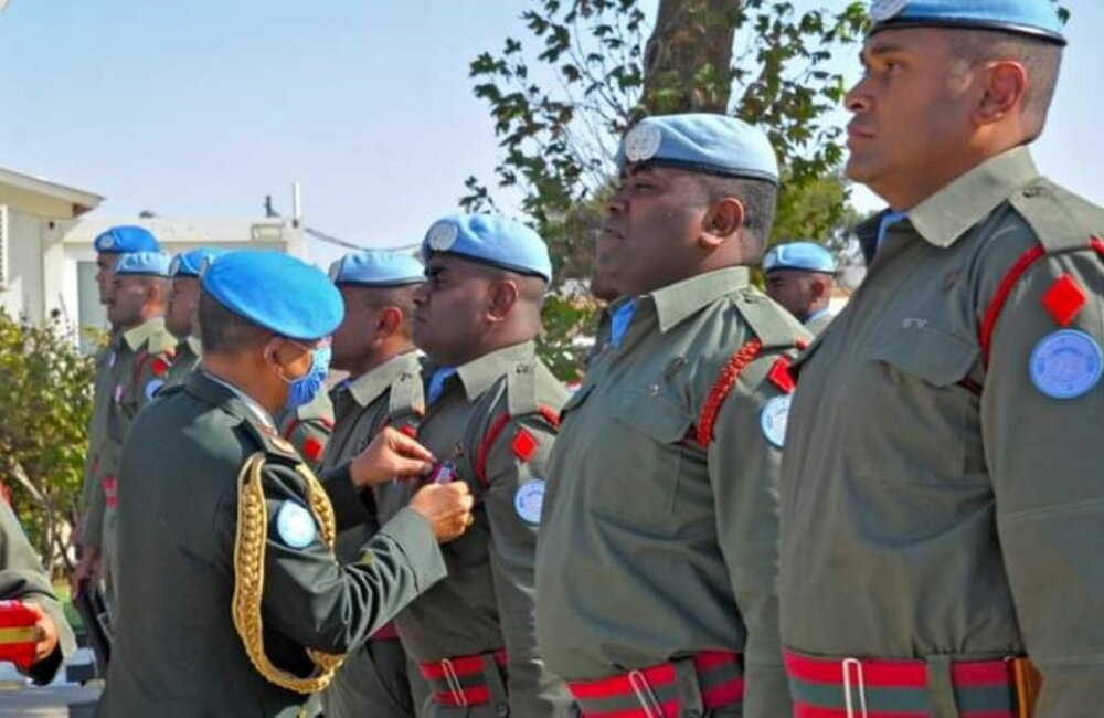 The Force Commander, Maj Gen Ishwar Hamal, Presenting UN Medals to the Fiji Troops on Parade