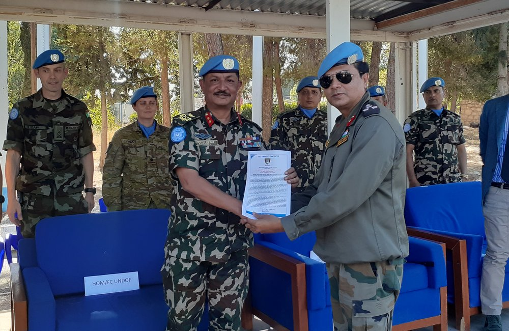 HoM and FC Maj Gen Shivaram Karil presents Brig Gen Kuldip Pattok with the Force Commanders Commendation on the occasion of the DFC,s Stand Down Parde