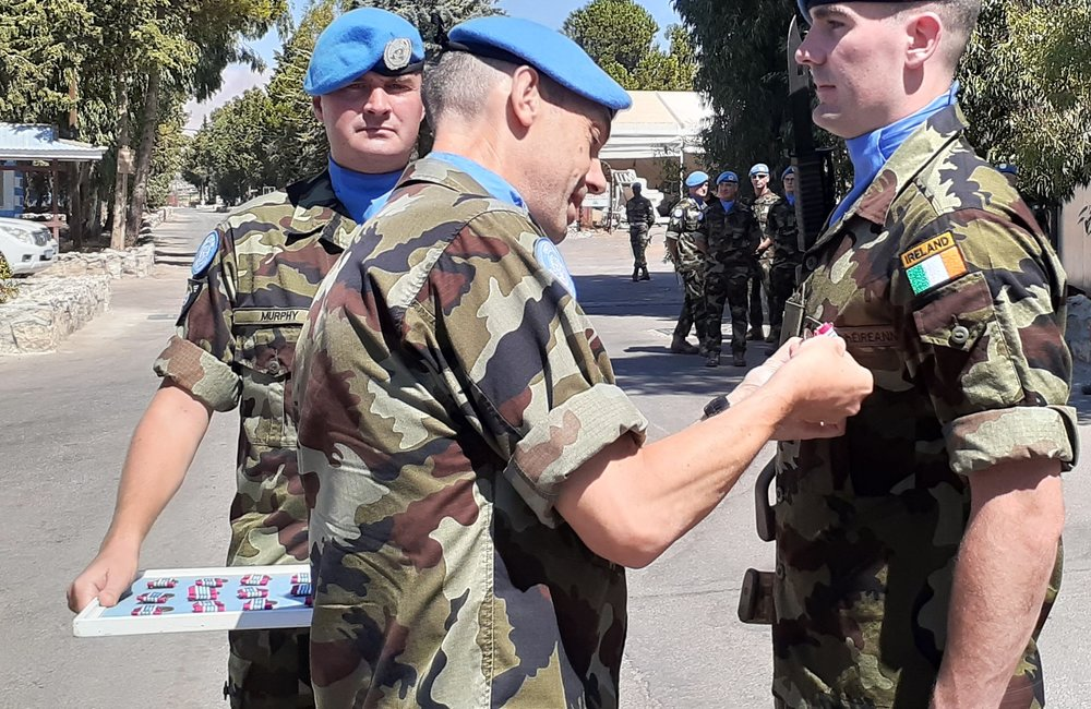 Lt Col Oliver Clear Chief Operations Officer UNDOF presents UNDOF Medals to 59th Inf Gp.