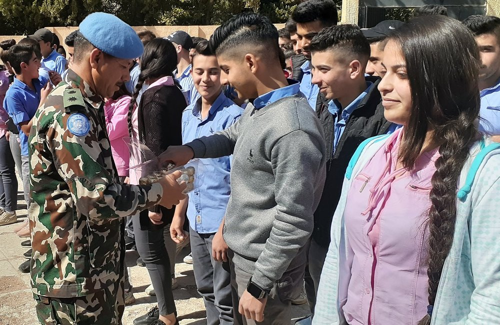Peacekeepers from NEPCON interact with the Students of Arneh School