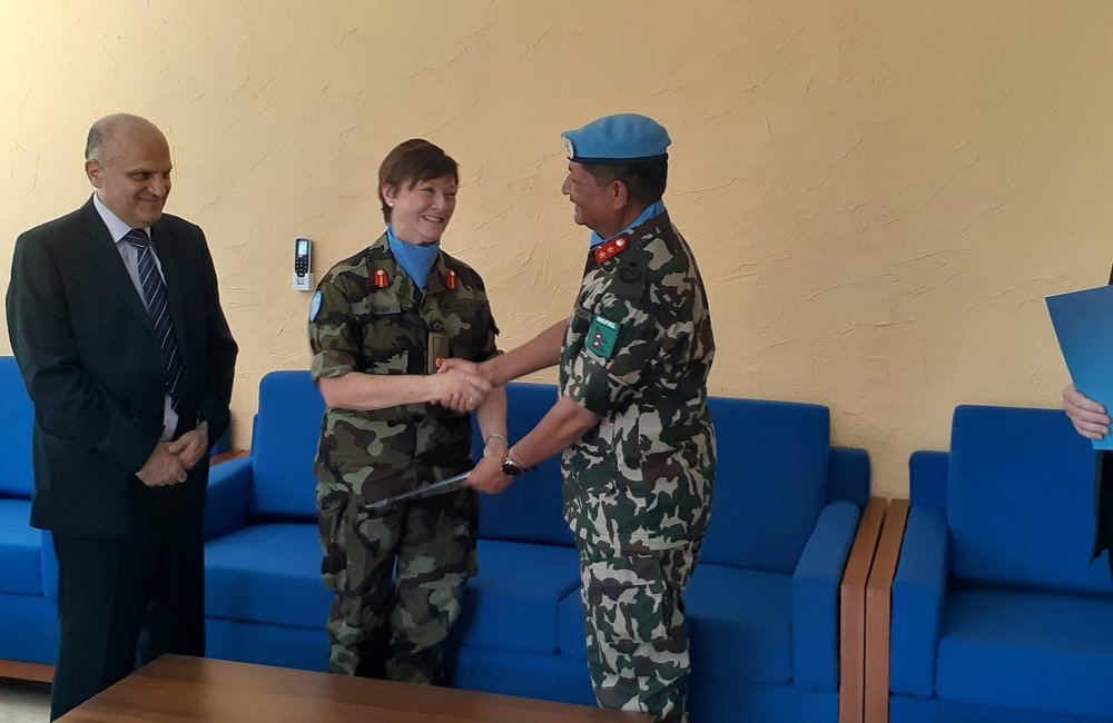 Maj Gen Shivaram Kharil Hands over command of UNDOF to Brig Gen Maureen O Brien.