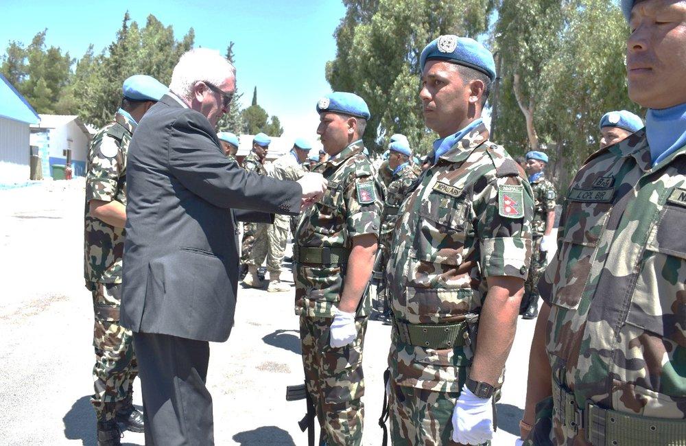 Mr Bernard Lee CMS presents UNDOF Peacekeeping Medals to Members of NMC