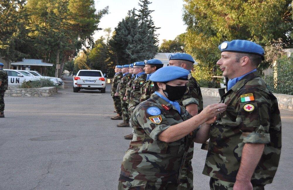The Deputy Force Commander, Brig Gen Maureen O'Brien, presenting UN medals to her fellow Irish troops on parade