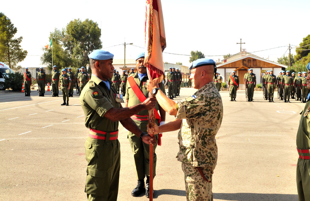 Lt Col Baka received the 1 FIR flag at the Handover Paade