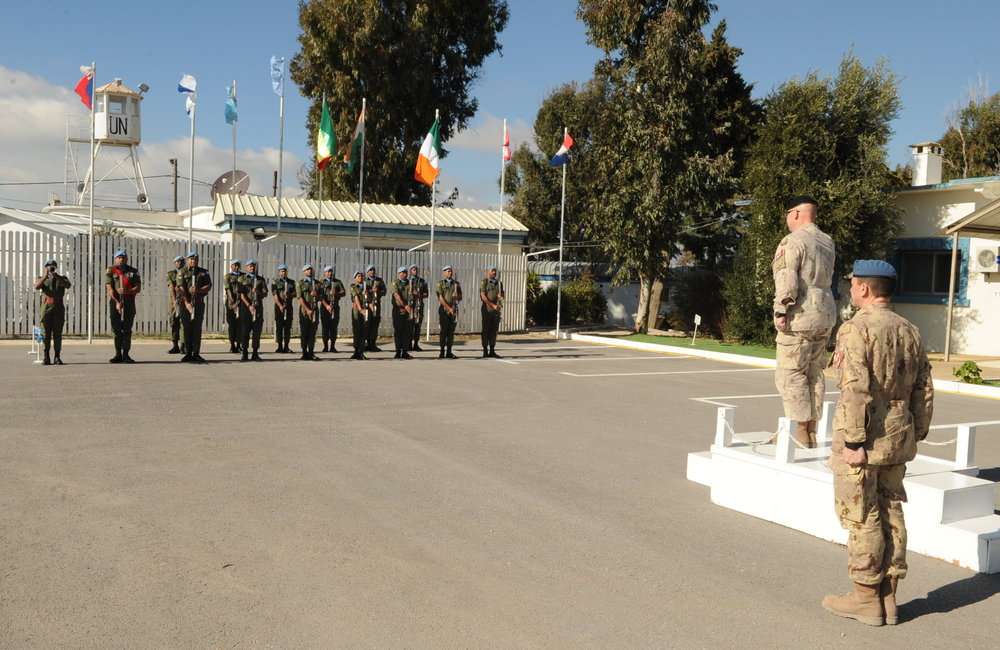 Rear Admiral Bob Auchterlonie receives a Fiji Batt Honor Guard outside UNDOF HQ