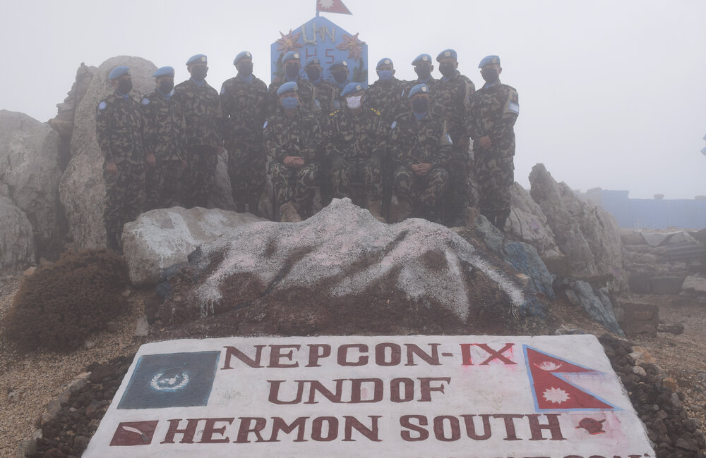 FC Lt Gen Ishwar Hamal and NEPCON pause for a photo on top of Mount Hermon, complete with cloud