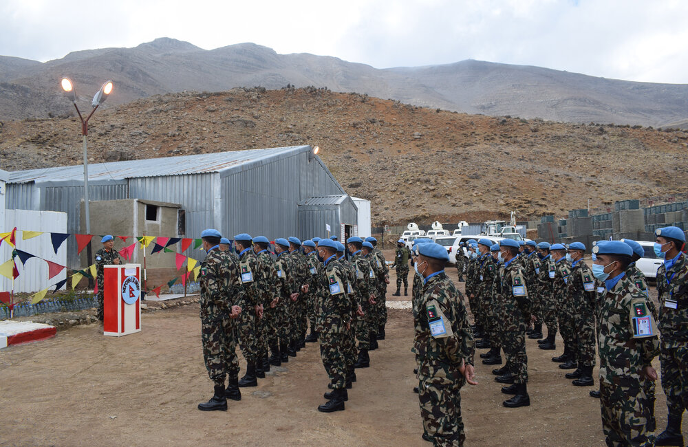 FC Lt Gen Ishwar Hamal briefs NEPCON IX troops with Mount Hermon standing tall in the background