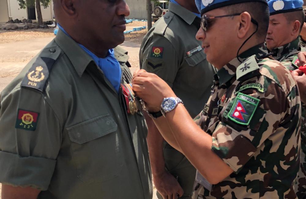 Lt Col Bijay O/C NMC presents UNDOF medal to Fiji Batt 6 personnel