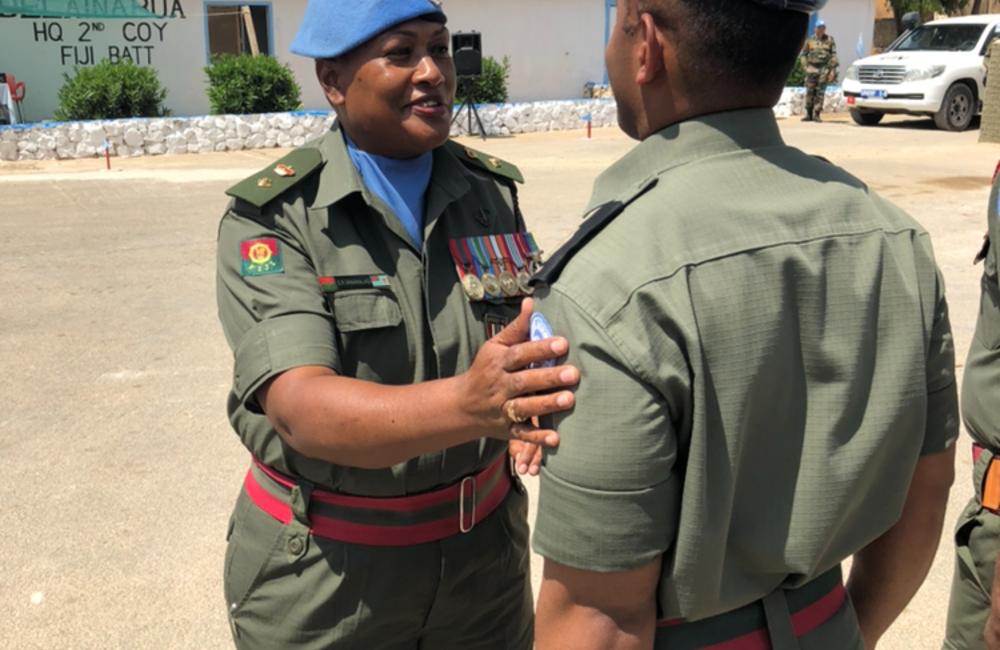 Lt Col S Vananalagi CMPO UNDOF presents UNDOF medal to Fiji Batt 6 personnel