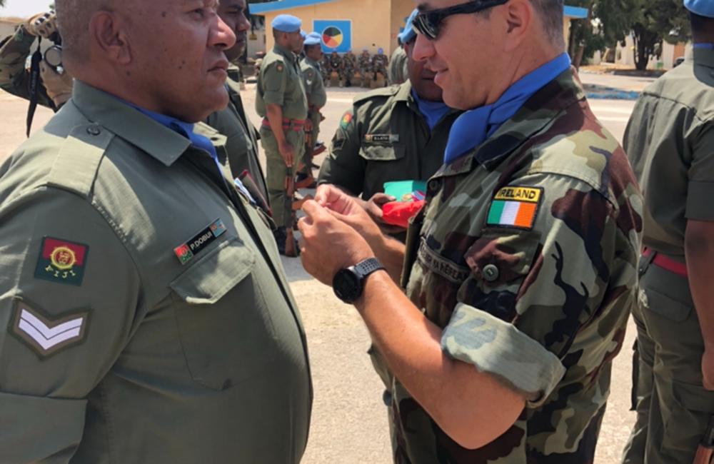 Lt Col L Flynn O/C FRC presents UNDOF medals to Fiji Batt 6 personnel