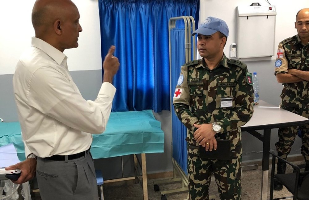 Rtd Maj Gen Menon is given a briefing by O/C Level 1 + Medical Facility Camp Faouar.