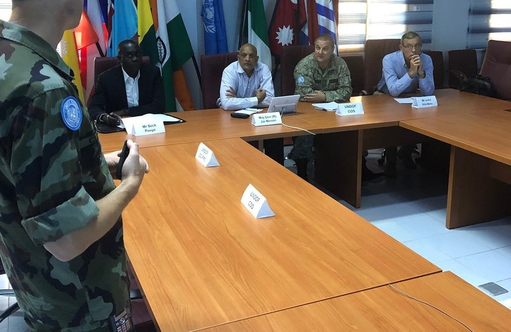 Rtd Maj Gen Menon recieves a comprehensive Operational Brief from Lt Col Olicer Clear COO UNDOF