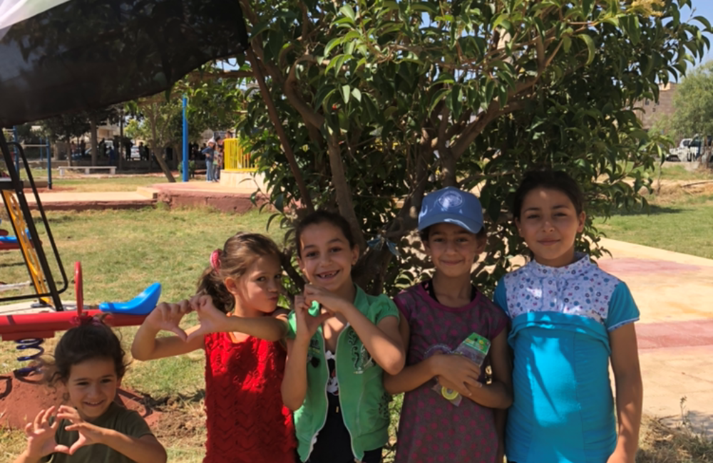 Children from Khan Arnabeh enjoying the opening of the new Playground.