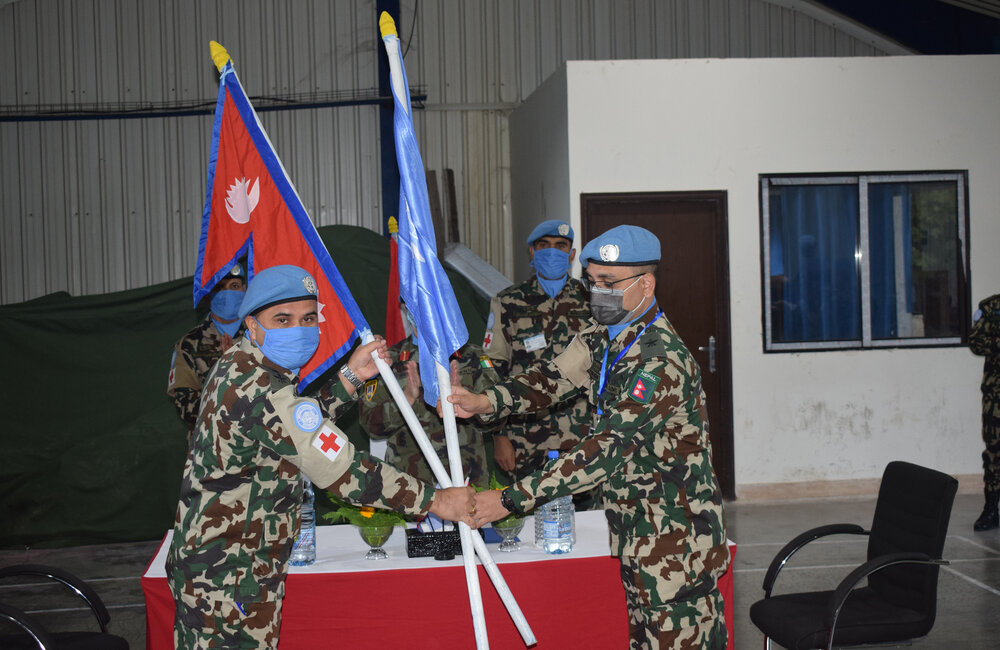 Nepalese Level 1+ Hospital Commanders exchange the UN Flag