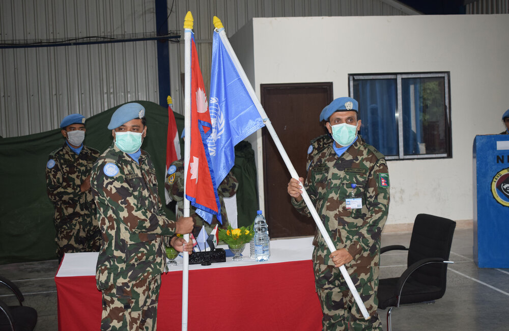 Nepalese Engineer Platoon Commanders exchange the UN Flag