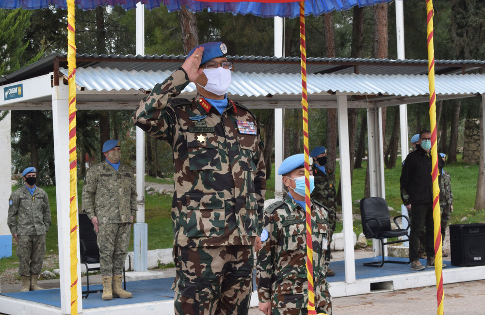 Force Commander and Head of Mission Lt Gen Ishwar Hamal receives the salute from the parade