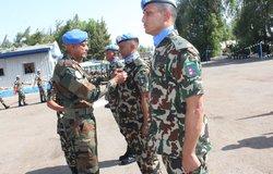 Force Commander Maj Gen Jai Shanker Menon awarding medal to Nep Con commander